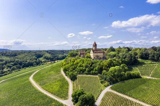 Germany- Baden-Wurttemberg- Brackenheim- Helicopter view of Schloss Stocksberg and surrounding fields in summer