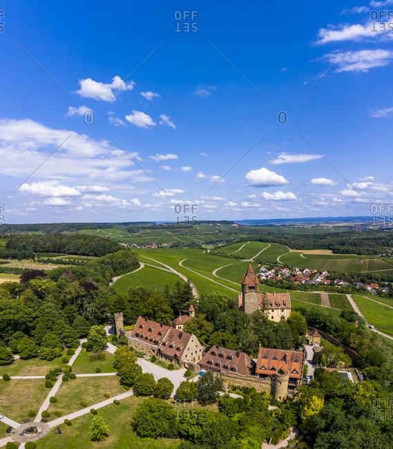 Germany- Baden-Wurttemberg- Brackenheim- Helicopter view of Schloss Stocksberg and surrounding village in summer