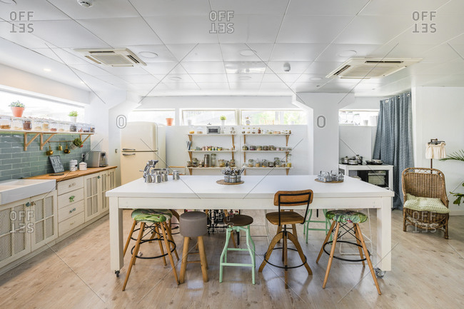 Seats arranged at kitchen island in cooking school