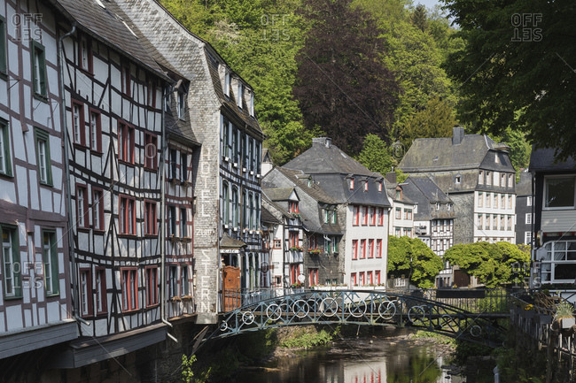 Germany- North Rhine-Westphalia- Monschau- Half-timbered houses along Rur river canal