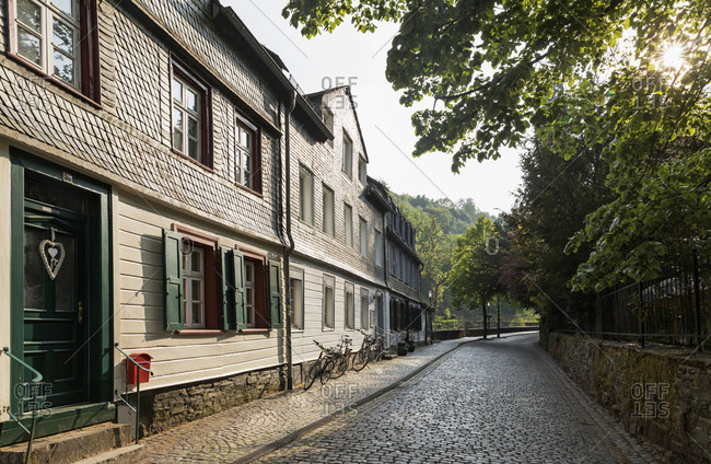 Germany- North Rhine-Westphalia- Monschau- Historic houses along empty cobblestone road