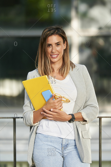 Confident female entrepreneur in smart casuals standing outdoors