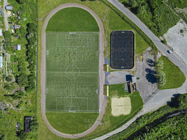 Russia- Republic of Karelia- Sortavala- Aerial view of empty football field and basketball court
