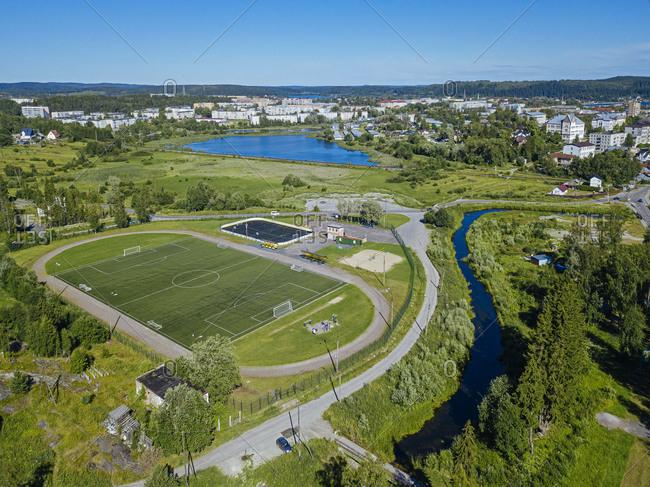 Russia- Republic of Karelia- Sortavala- Aerial view of riverside football field in summer