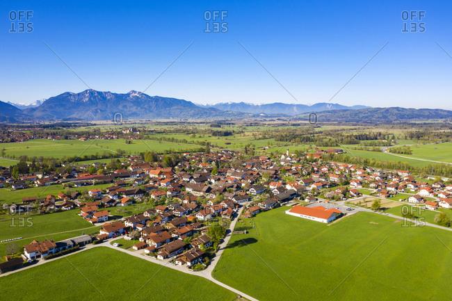 Germany- Bavaria- Bichl- Aerial view of village in Alpine Foothills in summer