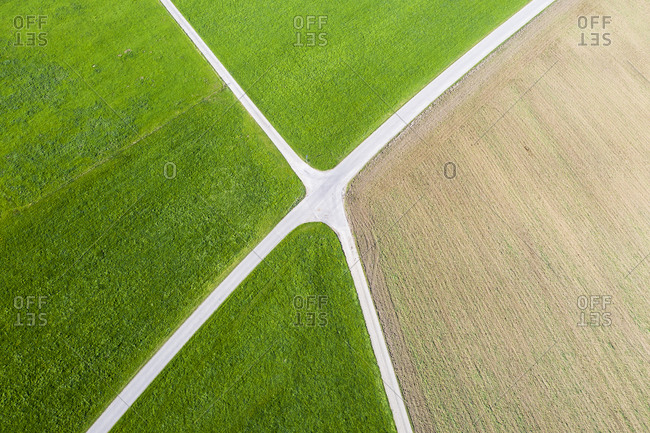 Germany- Bavaria- Bichl- Aerial view of countryside crossroad in summer