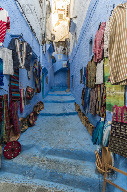 Craft products arranged on wall and steps for sale in old town- Chefchaouen- Morocco