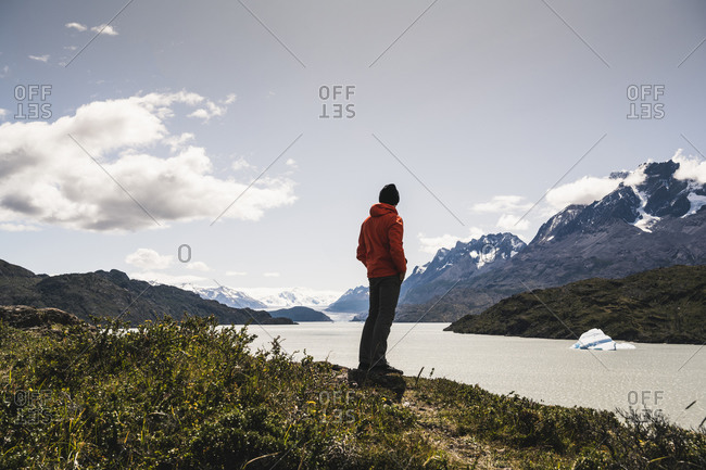Man standing and admiring view of Grey Glacier at Torres Del Paine National Park- Patagonia- Chile- South America