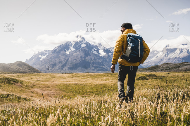 Man with backpack hiking at Torres Del Paine National Park in Patagonia- South America