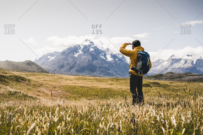 Man looking at view while exploring Torres Del Paine National Park in Patagonia- South America