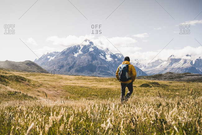 Man with backpack exploring Torres Del Paine National Park in Patagonia- South America