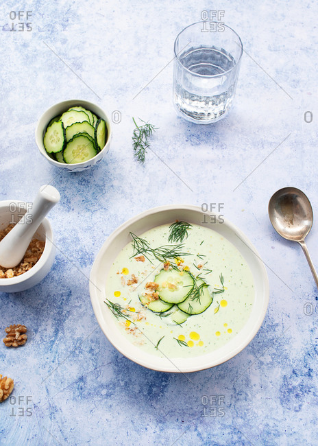 From above cold cucumber and dill soup named Tarator on rustic table