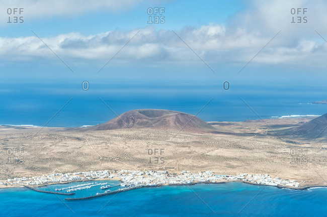 Spectacular scenery of Graciosa Island with blue sea and highlands from Mirador del Rio viewpoint in Lanzarote
