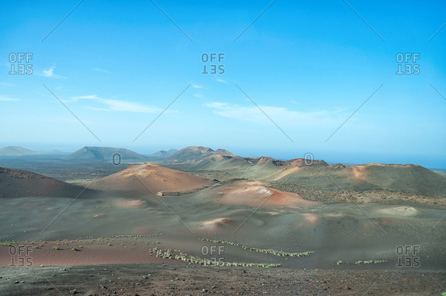 Breathtaking view of highlands under cloudless sky in Timanfaya National Park in Lanzarote