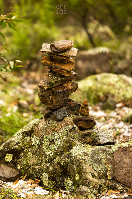 Stacked stone cairn with moss covered rocks