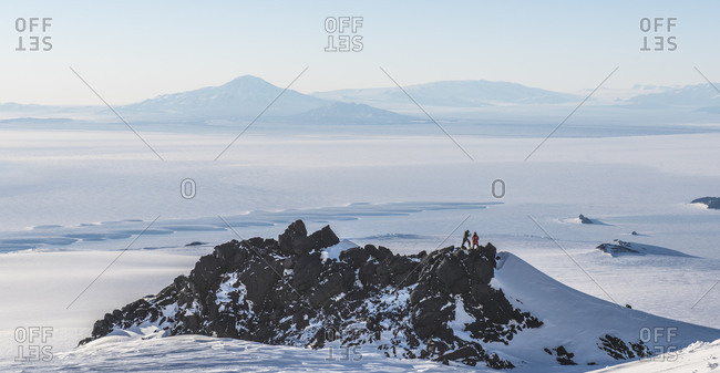 Scientists collect rock samples on the slopes of Mount Erebus, Antarctica.