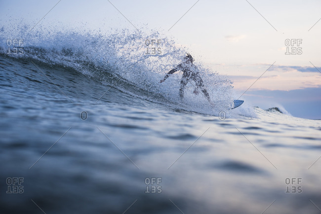 United States, Rhode Island, Narragansett - July 11, 2018: Surfer riding wave, Narragansett, Rhode Island, USA