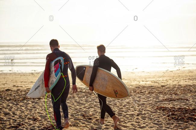 France, Morbihan, Le Loch - March 30, 2017: Surfers on beach, Leach Loch Guidel, Brittany, France