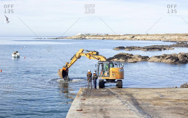 France, Morbihan, Ploemeur - October 7, 2018: Digger Dredging boat launch, Kerroch, Brittany, France.