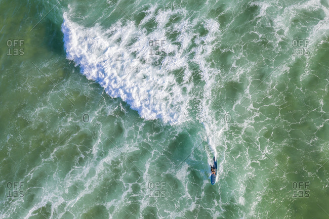 Surfer riding wave, Byron Bay, New South Wales, Australia