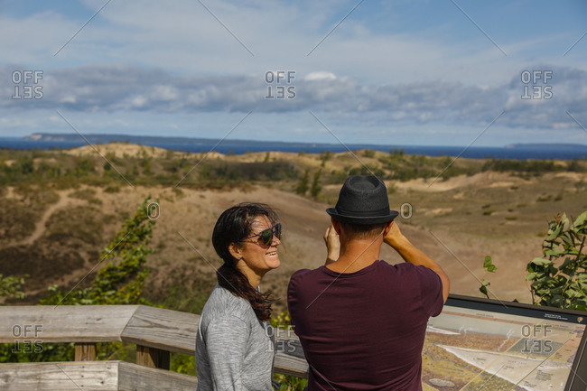 USA, Michigan, Empire - September 20, 2018: Couple admiring view of Sleeping Bear Dunes National Lakeshore, Empire, Michigan, USA