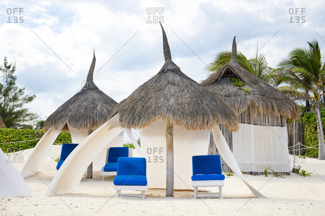 Mexico, Quintana Roo, Tulum - May 4, 2015: Beach huts and empty chairs at beach Tulum Quintana Roo, Mexico