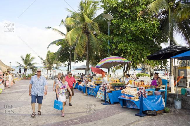 Mexico, Quintana Roo, Playa del Carmen - May 5, 2015: Tourists shopping at outdoor market, Playa del Carmen, Quintana Roo, Mexico