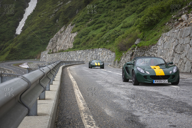 Switzerland, vaud, aletsch - June 13, 2018: Two cars on winding road, Aletsch, Vaud, Switzerland