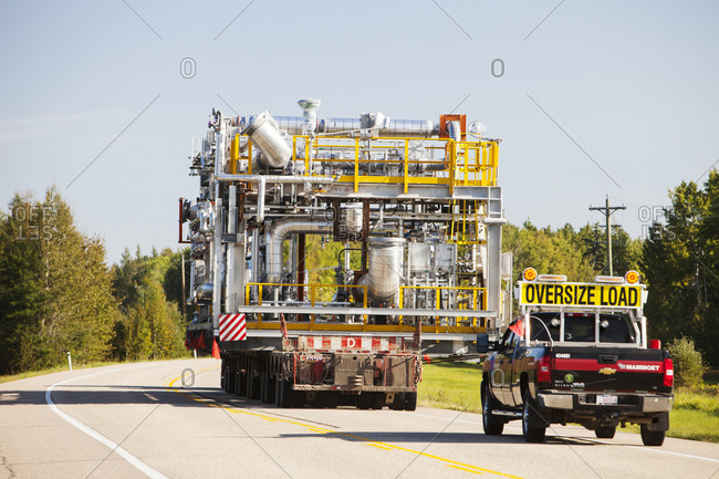 Canada, Alberta, Fort McMurray - August 18, 2012: Trucks hauling oversize load of tar sands equipment, Fort McMurray, Alberta, Canada