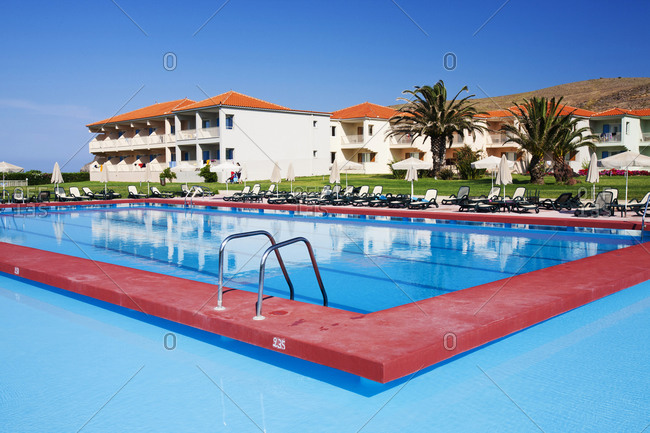 Greece, Lesbos, Skala Eresou - June 14, 2011: Swimming pool in holiday village, Skala Eresou, Lesbos, Greece