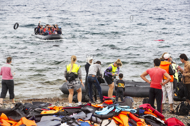 Greece, Lesvos - September 29, 2015: Syrian migrants on beach, Lesbos, North Aegean, Greece