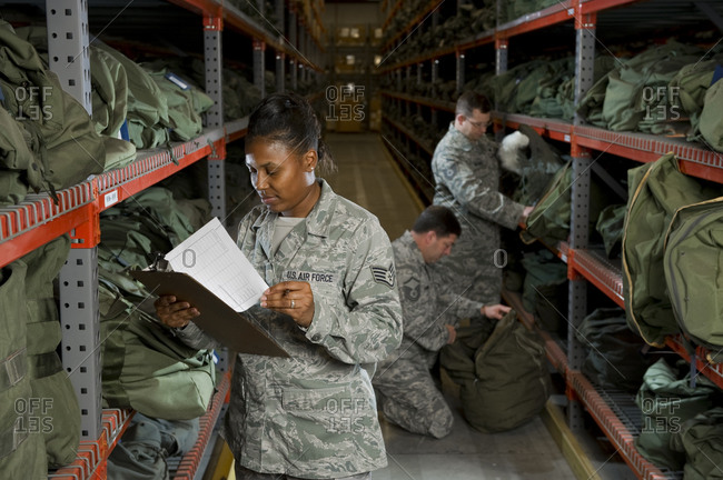 0 - February 5, 2011: A U.S. Air Force Staff Sgt. takes inventory of the military issued gear on the deployment line