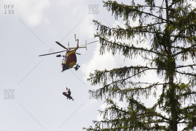 France, Haute Savoie, Annecy - May 19, 2018: Helicopter evacuating injured motorcycle rider, Annecy, Haute Savoie, France