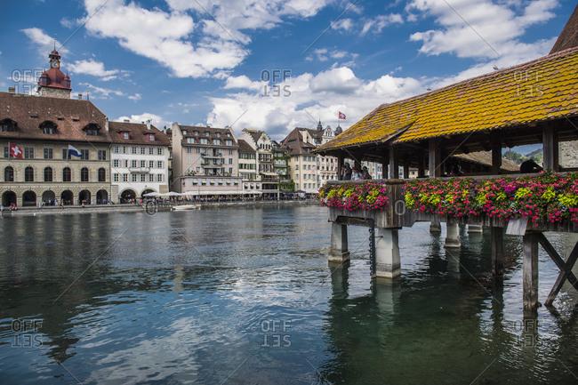 Switzerland, Lucerne, Lucerne - August 29, 2018: Kapellbrucke bridge over Reuss river, Lucerne, Switzerland