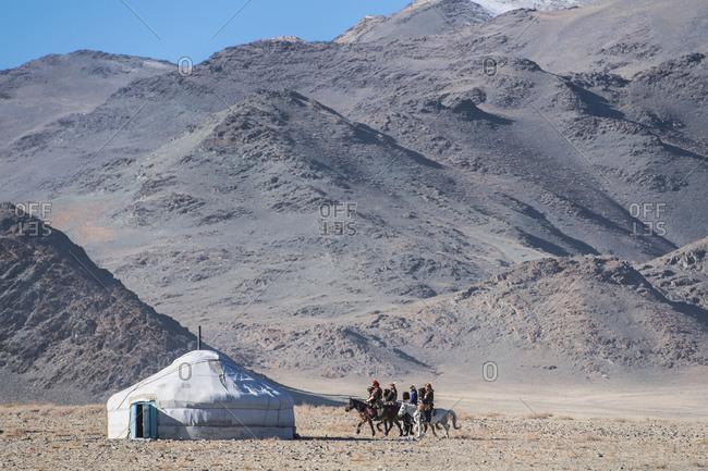 Mongolia, Bayan-Olgiy, Olgiy - October 6, 2018: Nomads on horses near yurt tent Oligemic Bayan-Olgiy, Mongolia