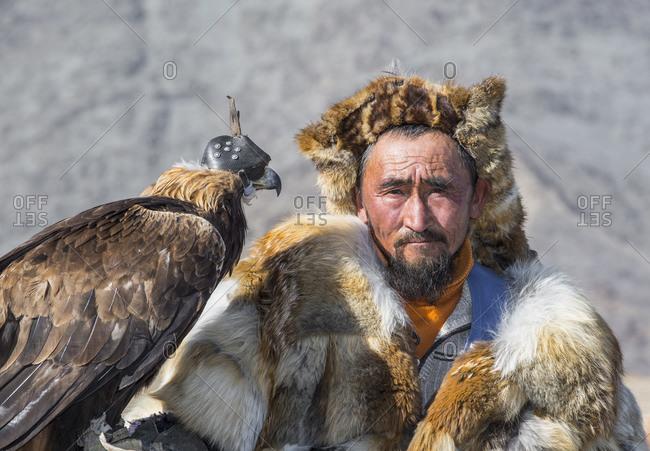 Mongolia, Bayan-Olgiy, Olgiy - October 6, 2018: Portrait of nomadic eagle hunter Oligemic Bayan-Olgiy, Mongolia