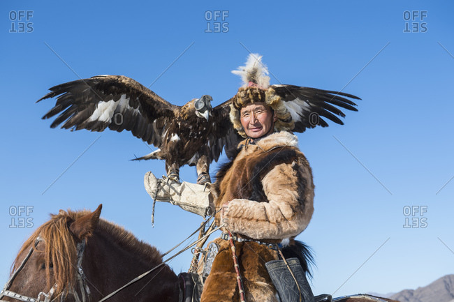 Mongolia, Bayan-Olgiy, Olgiy - October 6, 2018: Nomadic eagle hunter on horse Oligemic Bayan-Olgiy, Mongolia