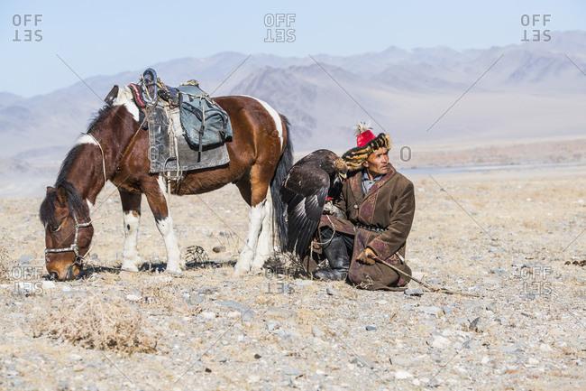 Mongolia, Bayan-Olgiy, Olgiy - October 7, 2018: Nomadic eagle hunter with horse Oligemic Bayan-Olgiy, Mongolia
