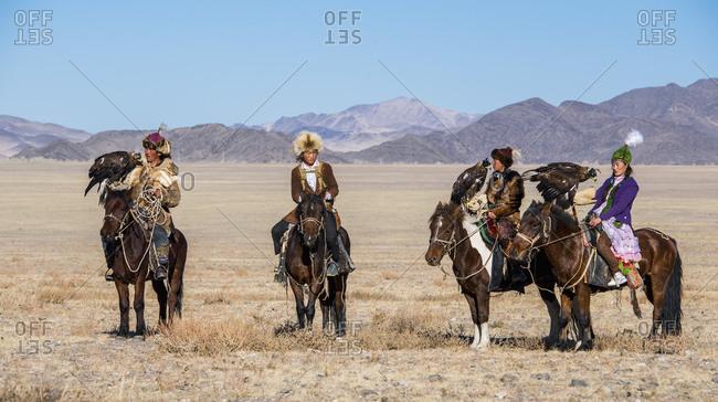 Mongolia, Bayan-Olgiy, Olgiy - October 7, 2018: Nomadic eagle hunters on horses Oligemic Bayan-Olgiy, Mongolia