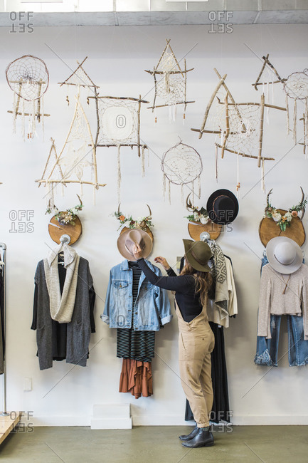 Woman shops in trendy, hipster store, Port Angeles, Washington, USA
