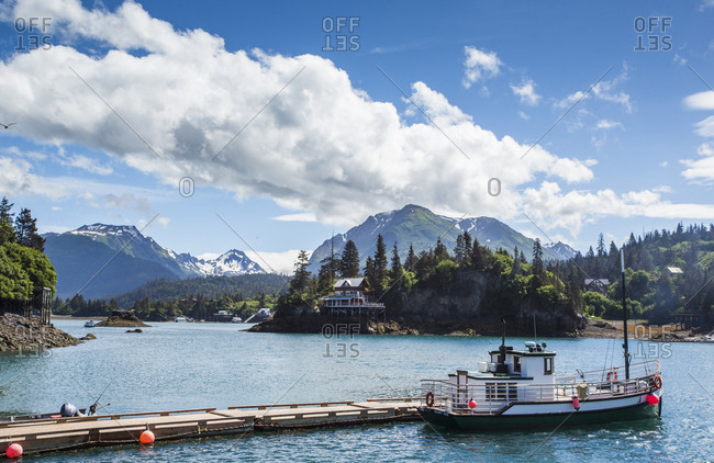 USA, Alaska, Halibut Cove - July 7, 2015: A small boat is moored in the calm waters of Halibut Cove, Alaska.