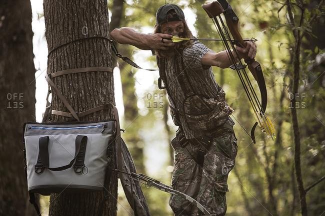 Deer hunter with bow and arrow, Bear Creek Reserve, Georgia, USA