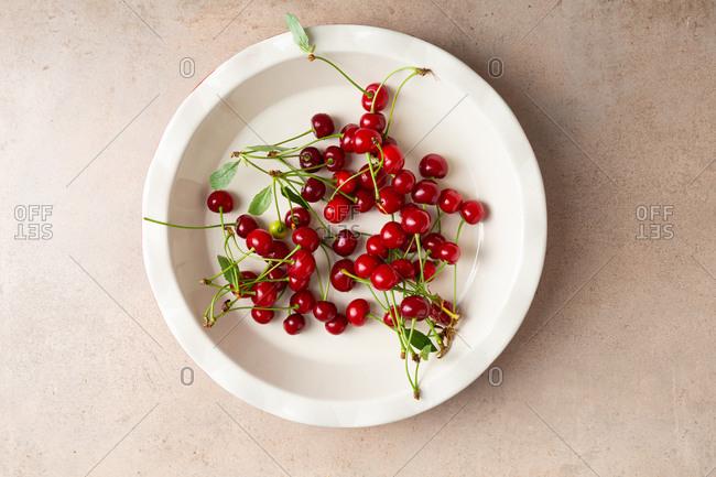 Overhead view of fresh cherries in baking dish