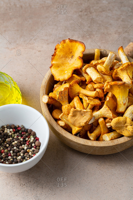 Close up of chanterelles mushrooms in wooden bowl