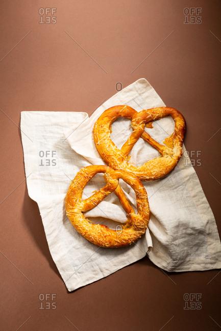 Salty pretzels on linen cloth