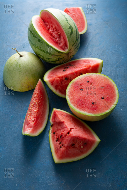 Sliced ripe watermelons on blue background