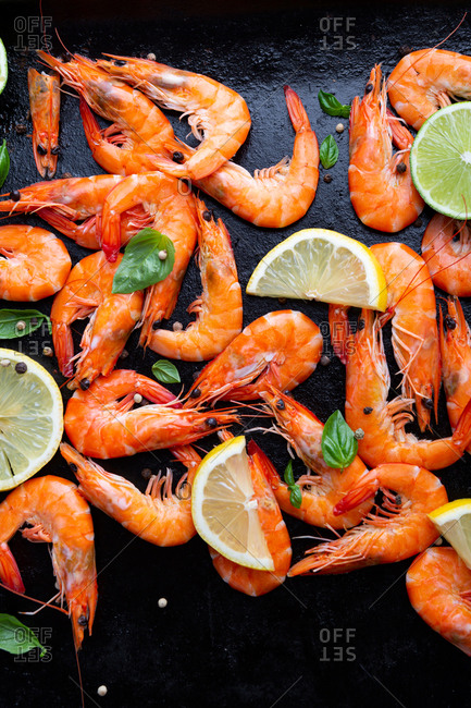 Overhead view of seafood prawn on dark cooking sheet