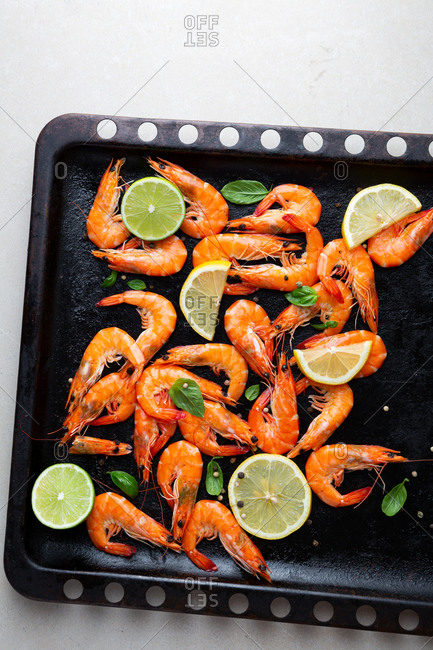 Prawn with lime on baking sheet