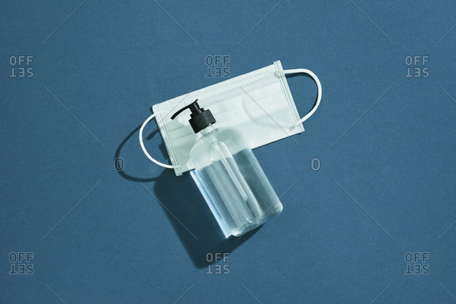 Surgical mask for wearing germ protection and gel alcohol or hand sanitizer bottle for washing hand to protect from corona virus set