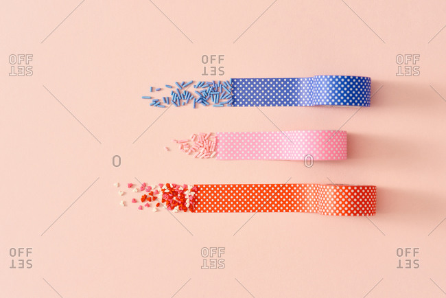 Candies, sprinkles, and tape in a pastel color